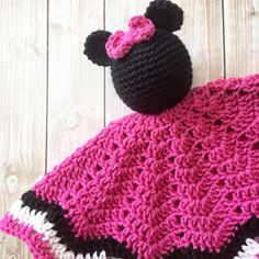 Your little princess will love this Minnie Mouse inspired doll lovey! It is made of soft acrylic yarn. The skirt measures approximately 16 at its widest point. The doll is approximately 13 tall. All parts are securely attached. Material: 100% acrylic yarn Care Instructions: Hand