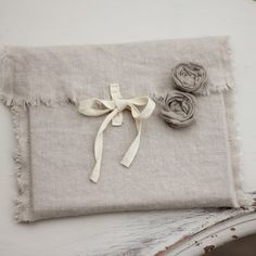 . . . or if you REALLY want to be fancy, cloth envelopes (here, linen).
