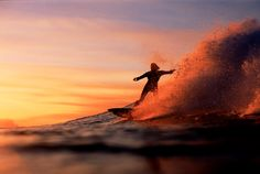 Sunset surfer at Anantara Maldives.