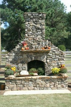 Outdoor fireplace with mums