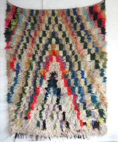 Boucherouite rug. This is a type of rag rug made from scrap fabric torn from used clothing.