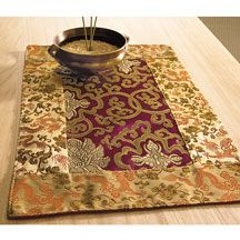 Handcrafted in Nepal, this Tibetan brocade altar cloth is made of traditional plum and gold brocade fabric. Place this beautiful textile under statues or ritual objects on your Buddhist altar to show honor and respect.