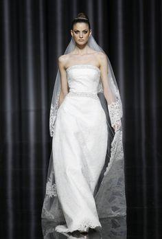 Brides: Pronovias - Fall 2012. Strapless lace A-line wedding dress with beaded details at the neckline and waist, Pronovias