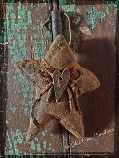 Lovely folk art star I created from wax by: Ye Olde Crow Primitives
