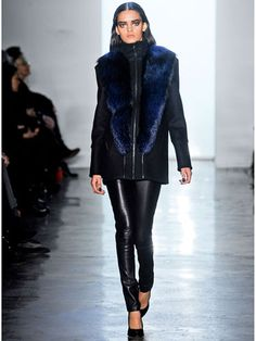 Black & Blue  Cushnie et Ochs  At all the femme fatale looks on the designers' runway, it didn't get more luxe than this zipped-up black coat with midnight blue fur trim.