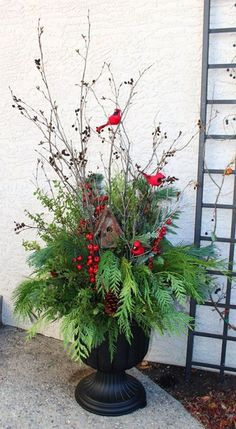 by deirdre 24 Stunning Christmas pots and planters to DIY for almost free! How to create colorful winter planters as beautiful Christmas outdoor decorations, with evergreens, berries, pinecones, branche by deirdre 24 Stunning Christmas pots. Christmas Urns, Christmas Garden Decorations, Christmas Arrangements, Outdoor Decorations, Outdoor Christmas Planters, Decorating For Christmas Outdoors, Christmas Front Porches, Outdoor Pots And Planters, Outdoor Christmas Decor Porches