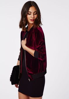 This sporty stretch burgundy jacket with contrast ribbed collar and cuffs and a blingin' gold zip is luxe street wear at its best. It doesn't get more on trend for the new season than this velvet touch velour zip up bomber jacket. Style you...