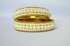 Check out this item in my Etsy shop https://www.etsy.com/listing/537079064/indian-bangles-white-beaded-bangle