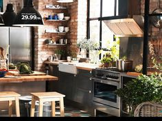 IKEA Kitchen - love the wood, stainless, black & brick.