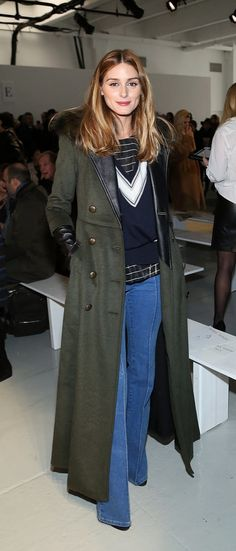 At the Misha Nonoo show, Olivia Palermo brought '70s style with flared jeans.
