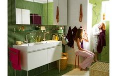 Love the green tile in this Ikea bathroom. don't care so much for the flower detailing near the shower though..