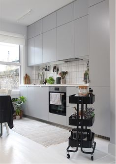 A Scandi-inspired kitchen A grey kitchen along one wall with white tile splashback and white worktop. One Wall Kitchen, Kitchen Room Design, Living Room Kitchen, Home Decor Kitchen, New Kitchen, Minimal Kitchen, Living Room Plan, Living Room Modern, Living Rooms