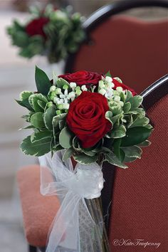 Claire's wedding flowers, red and white, classic with some contemporary touches.       Wedding bouquet of Grand Prix roses with white singa...