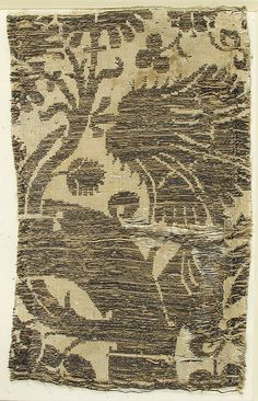 Textile with Brocade Date: 14th century Geography: Made in, Venice?, Italy Culture: Italian Medium: Silk, gold thread Dimensions: Overall: 6 5/16 × 4 1/8 in. (16.1 × 10.5 cm) Storage (Mat): 13 × 8 1/2 in. (33 × 21.6 cm) Classification: Textiles Credit Line: Rogers Fund, 1909 Accession Number: 09.50.1024