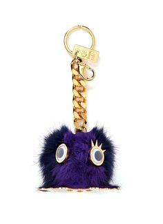 Sophie Hulme introduces an eye-catching furry friend to help you easily spot your keys in the bag. Showcasing a monster charm crafted from luxurious rabbit fur and gold-tone metallic hardware, this quirky keyring will secure your valuables with beguilement.