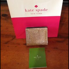 Kate Spade card wallet MSRP $65 Kate Spade beautiful Rose Gold id/card wallet.  small zip coin pocket on back side. Interior has window slot for id, and 4 slots for cards. snap closure. comes with Kate Spade care instruction booklet, Kate Spade gift bag and tissue. kate spade Bags Wallets