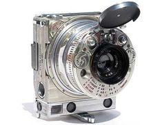 The 1930's Jaeger LeCoultre-Compass Camera was the result of a bet in which Lord Noel Pemberton Billing boasted he could create a camera that could fit inside a cigarette packet. Way ahead of its time this beautiful 35 mm camera featured an exposure meter, range finder, EV indicator, angle viewfinder, telescopic lens shade, inbuilt filters, and a device for panoramic and stereoscopic views. via gajitz and jaeger-lecoutre.com #Camera #Jeager_Lecoultre_Compass