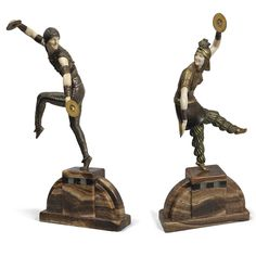 Demeter H. Chiparus 'RUSSIAN DANCERS': A PAIR OF FIGURES silvered, gilt and cold painted bronze and ivory, brown onyx bases with Portor marble and onyx chequered detail, each base marked 'D.H. Chiparus' and 'Etling Paris'