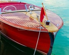 Two toned classic wooden boat docked at side slip Stock Photo