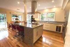 Large open kitchen with island cooktop. www.thekitchendeisgncentre.com.au