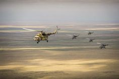 In a photo provided by NASA, Russian search and rescue helicopters fly over Kazakhstan, Tuesday, Sept. 10, 2013, from the city of Karaganda ...
