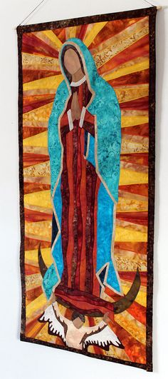 Our Lady of Guadalupe art quilt wall hanging. This art quilt was constructed using a variety of batik fabrics. Approximate size is X from Catholic Art, Religious Art, Images Of Mary, Quilted Wall Hangings, Blessed Mother, Barbie, Small Quilts, Kirchen, Virgin Mary