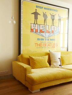 I don't know how I feel about a velvet sofa, but I like that colour, and that giant poster.