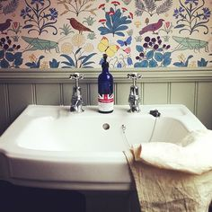 Apothecary's Garden wallpaper in bathroom from Orlando and the Fountain blog. Am told this is Charles Voysey paper.