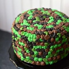 camouflage pom pom cake - chocolate and vanilla cake filled with oreo whipped cream and covered with camoflauge pom pom frosting