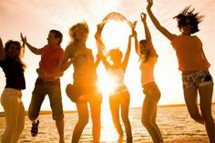 Photo about Group of happy young people dancing at the beach on beautiful summer sunset. Image of celebration, friends, relationships - 15101416