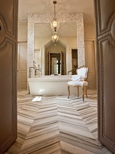 a chevron pattern that is created by using slab strips  of a linear marble to create a softer but very interesting design.