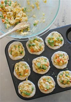 chicken potpie cupcakes    Ingredients  1 chicken breast, poached and diced  1 (14.5 oz) can cream of chicken soup  1 cup frozen mixed veggies  1 cup shredded cheddar cheese  1 Tbs Herbs De Provence  1 tsp onion powder  1 tsp garlic salt  2 (10 oz) cans Pillsbury biscuits    Directions  1Preheat your oven to 400.  2In a large bowl, combine the cook