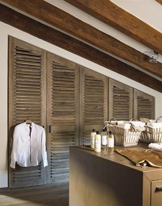 clever shutter doors on attic closet...... I can put hinges on these and use and a screen