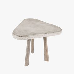Polished concrete topped table with wooden legs makes for an unique side table for a chair or sofa.