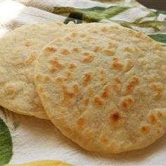 Chef John's Flour Tortillas: Allrecipes.com I don't feel like going to the grocery store with my 3 kiddos tonight so I think I will give these a try!