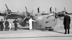 G-AGCB. British Airways - in the wartime livery at Port Washington Marine Terminal, La Guardia, August 1945.  © Whites Aviation / Alexander Turnbull Library Image WA-00473-F via P. Sheehan Collection - 1950-097.