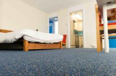 Existing floorcoverings at Kings College were removed before installation of Gradus carpet tiles using Styccobond F41
