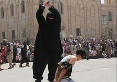 ISIS operative decapitates a young boy The boy, Ayham Hussein, was discovered by ISIS henchman as he was listening to a portable compact disc player.  Photo By: ARAB MEDIA