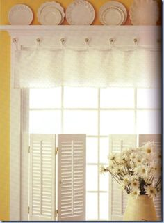 Valance: They have added glass knobs for hanging the valance. Looks like they made this valance out of a dainty table runner. Cute idea!