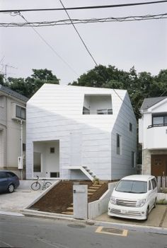 This is a home built in Yokohama, Japan, for a couple and their two kids.