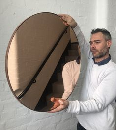 "Delightful crafted Peach/Rose Gold tinted round mirror with copper frame. Design and hand-crafted in London, UK.   Also available in:  Small: 40cm/15.8""  Regular: 50cm/19.7""  Medium: 60cm/23.6""  Large: 79cm/31.1""  Extra Large: 100cm/39.4""   or any bespoke dimension; contact us for a quote.  We ship safely worldwide.  Beautiful above a console table or a fireplace, in a bathroom, restroom or bedroom, and anywhere in a home or a commercial/hospitality space."