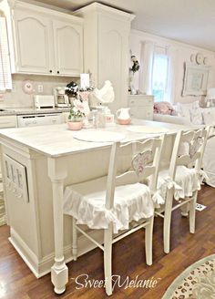 Cream Colored Cabinets and Ruffled Seat Covers