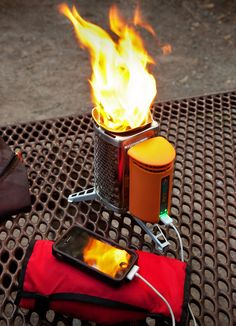 Cool stuff for the outdoors - Biolite backpackers camping stove. Burns sticks, useful for cooking, pine cones, etc- no fossil fuel. Excess heat charges your electronics. Auto Camping, Camping Stove, Camping Survival, Camping And Hiking, Emergency Preparedness, Survival Gear, Camping Hacks, Backpacking, Hiking Gear