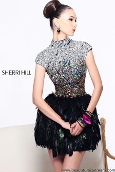 Sherri Hill 21045 - One of a kind Sherri dress with a beaded bodice and black feathered skirt. This is a statement piece.