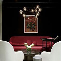 Dark interior, red settee /hayonstudio