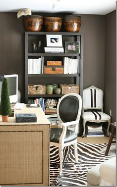 Ashley Goforth used two different contemporary styled Louis chairs – one with black leather and one with a black and white stripe.