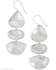 My new favorite earrings... they look so good on!!  Three organic shapes meet up beneath your ears. Sterling Silver.