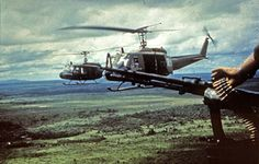 Bell UH-1 Iroquois (Huey) helicopters in flight over Vietnam ca. late 1960s/early 1970s.