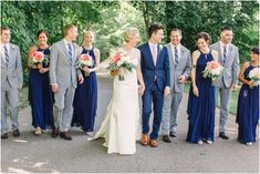 i like that the groom's blue suit matches the bridesmaids' dresses