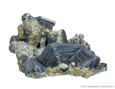 Djurleite, Ait Agmane, Bou Azer District, Ouarzazate Province, Morocco, Thumbnail, 2.1 x 2.0 x 0.8 cm, A choice thumbnail from this very memorable find...Perched on matrix are a few, thin tabular, matte lustered, dark gray crystals of djurleite, highlighted by a crystal measuring 1.3 cm across., For sale from The Arkenstone, www.iRocks.com. For more details on this piece and others, visit http://www.irocks.com/minerals/specimen/46283
